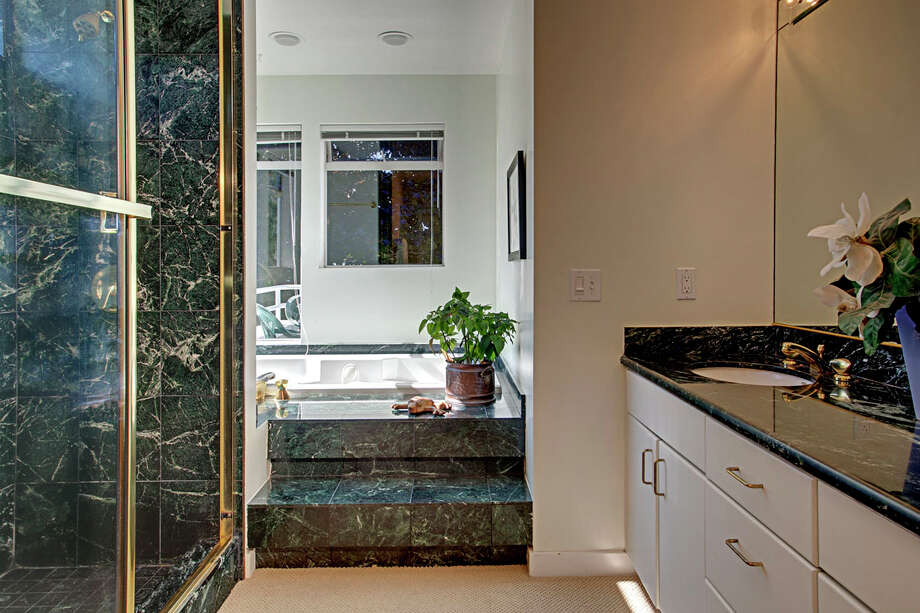 Master bathroom of 4000 W. Dravus St., is more contemporary. The 3,260-square-foot house, built in 1992, has three bedrooms and 2.75 bathrooms, a surround sound system, a patio, multiple balconies, a rooftop deck and a two-car garage. It's listed for $850,000. Photo: John G. Wilbanks/Courtesy Ally Wangsness/RE/MAX Metro Realty