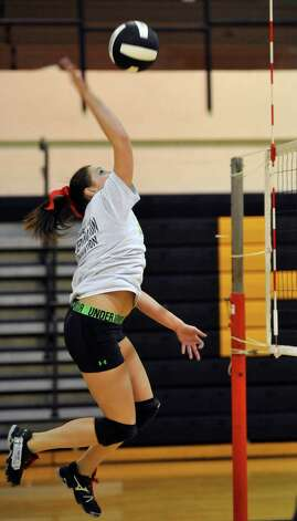 Taylor Konchaba spikes the ball back over the net during warmups. The Nederland girls volleyball team is in the playoffs again this season and will be playing Barbers Hill on Tuesday. They were practicing for the game Monday afternoon in the gym under the direction of 32 year veteran coach Toni Leach. Dave Ryan/The Enterprise Photo: Dave Ryan