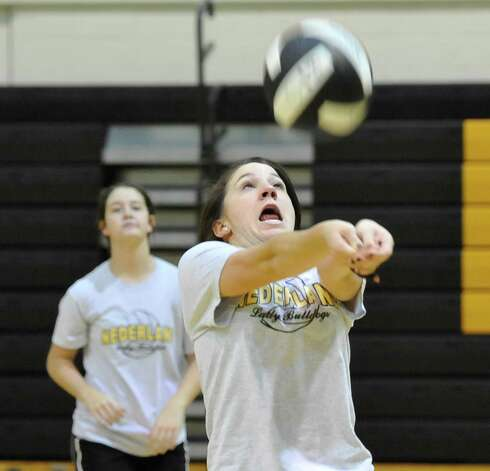 Felicia Sauceda hits the ball square as she yells out to her teammates.  the ball back over the net during warmups. The Nederland girls volleyball team is in the playoffs again this season and will be playing Barbers Hill on Tuesday. They were practicing for the game Monday afternoon in the gym under the direction of 32 year veteran coach Toni Leach. Dave Ryan/The Enterprise Photo: Dave Ryan