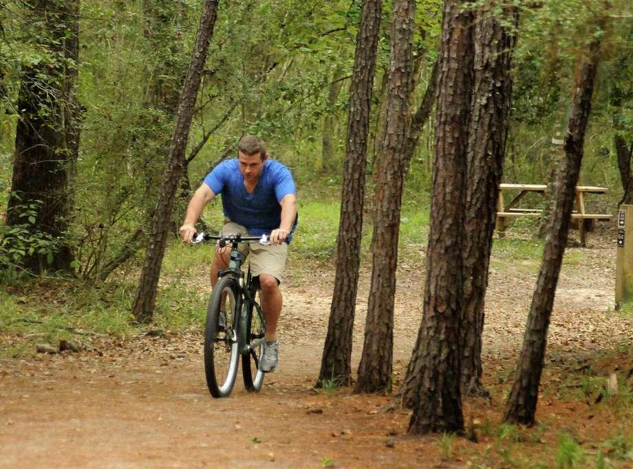 The Woodlands resident Anthony Denyer rides his bike almost daily on the Flintridge Trail. Photo: David Hopper, Freelance / freelance