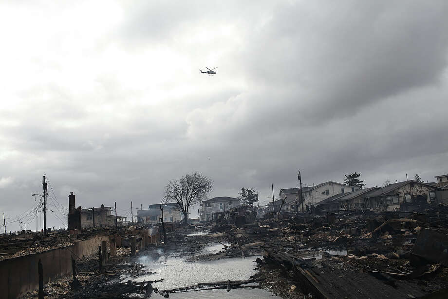 NEW YORK, NY - OCTOBER 30:  Homes destroyed during Hurricane Sandy are viewed on October 30, 2012 in the Breezy Point neighborhood of the Queens borough of New York. At least 33 people were reported killed in the United States by Sandy as millions of people in the eastern United States have awoken to widespread power outages, flooded homes and downed trees. New York City was hit especially hard with wide spread power outages and significant flooding in parts of the city. Photo: Spencer Platt, Getty Images / 2012 Getty Images