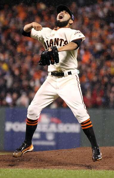 San Francisco Giants pitcher Sergio Romo celebrates the Giants NLCS Championship over the St. Louis