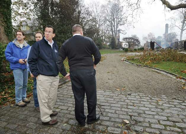 Gov. Dannel P. Malloy, third from left, views the scene of the aftermath of a house fire at 44 Binney Lane in Old Greenwich with Greenwich Fire Chief Peter Siecienski, right, the day after Hurricane Sandy hit Old Greenwich, Tuesday afternoon, Oct. 30, 2012. At left is Congressman Jim Himes and Greenwich First Selectman Peter Tesei, second from left. Photo: Bob Luckey / Greenwich Time