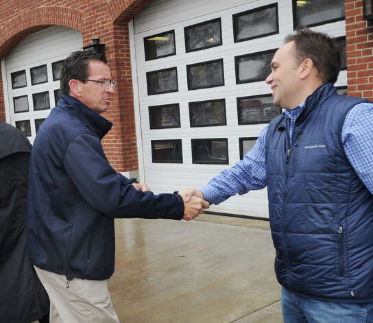 At left, Gov. Dannel P. Malloy shakes hands with Greenwich First Selectman Peter Tesei at the Sound Beach Fire House the day after Hurricane Sandy hit Old Greenwich, Tuesday morning, Oct. 30, 2012. The Governor visited Binney Lane in Old Greenwich where three homes caught fire during the hurricane. Photo: Bob Luckey / Greenwich Time