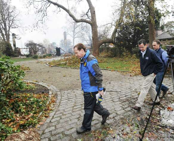 Gov. Dannel P. Malloy, second from left, tours the site of a house fire at 44 Binney Lane in Old Greenwich the day after Hurricane Sandy hit Old Greenwich, Tuesday afternoon, Oct. 30, 2012. At right is Greenwich First Selectman Peter Tesei. Photo: Bob Luckey / Greenwich Time