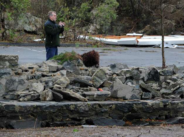 A man views the damaged seawall in Byram Park during the aftermath of Hurricane Sandy in Byram, Tuesday morning, Oct. 30, 2012. Photo: Bob Luckey / Greenwich Time