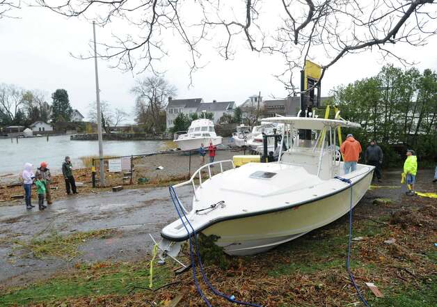 A motorboat in the middle of a road in Byram Park during the aftermath of Hurricane Sandy in Byram, Tuesday morning, Oct. 30, 2012. Photo: Bob Luckey / Greenwich Time