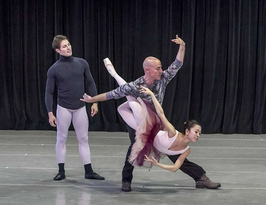 "New Ballet San Jose artistic adviser Wes Chapman (center) rehearses Maykiel Solas and Junna Ige of Ballet SJ in the ""Don Quixote"" pas de deux, which Chapman is staging in February. Photo: Robert Shomler, Ballet San Jose"