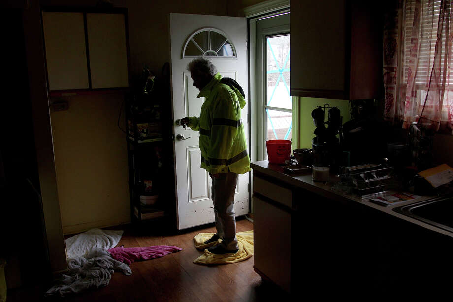 Carol Mason mops her flooded floor with towels after returning to her home in Atlantic City, N.J., Tuesday, Oct. 30, 2012. Many homeowners who suffered losses because of flooding from Hurricane Sandy are likely to find themselves out of luck. Standard homeowners policies don't cover flooding damage, and the vast majority of homeowners don't have flood insurance. Yet it's likely that many Northeasterners will purchase it in coming months, hoping they'll be covered the next time around, at a cost averaging around $600 a year. Photo: AP