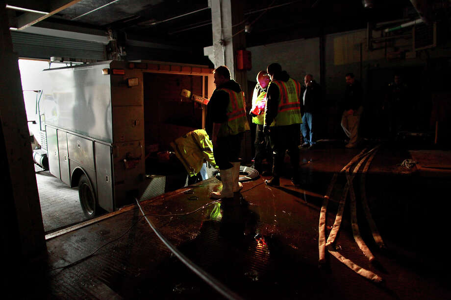 NEW YORK, NY - OCTOBER 30: A crew works to pump water from the basement of the Verizon Building October 30, 2012 in lower Manhattan, New York. The storm has claimed at least 16 lives in the United States, and has caused massive flooding across much of the Atlantic seaboard. US President Barack Obama has declared the situation a 'major disaster' for large areas of the US East Coast including New York City. Photo: Allison Joyce, Getty Images / 2012 Allison Joyce