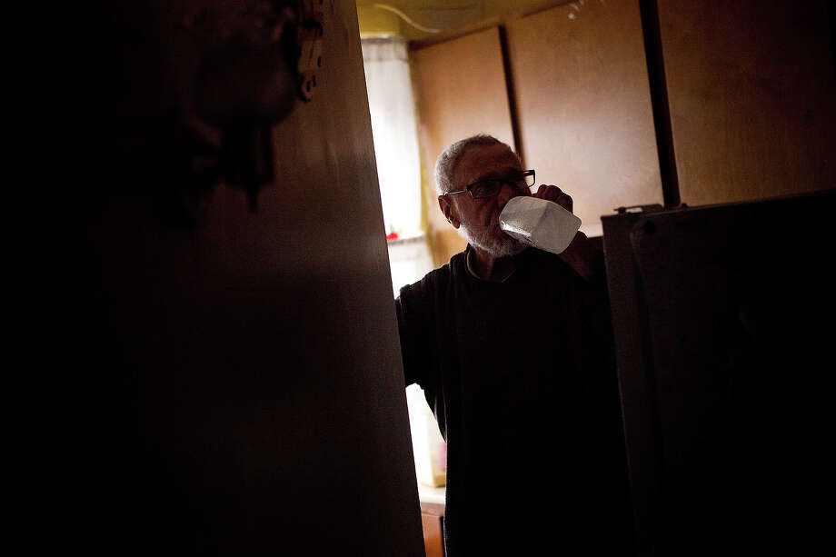 NEW YORK, NY - OCTOBER 30:  Jolito Ortiz takes a break to have a drink while helping clean out of his friend's apartment after flooding caused by Hurricane Sandy on October 30, 2012, in the Lower East Side of New York City. The storm has claimed at least 16 lives in the United States, and has caused massive flooding accross much of the Atlantic seaboard. US President Barack Obama has declared the situation a 'major disaster' for large areas of the US East Coast including New York City. Photo: Andrew Burton, Getty Images / 2012 Getty Images
