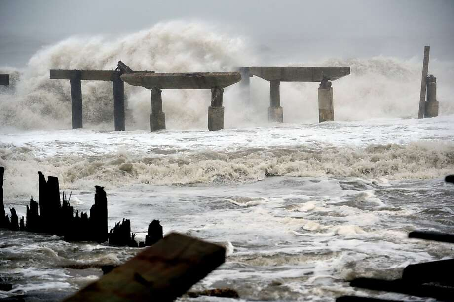 Waves hit a previously damaged pier in Atlantic City, N.J. There is debate about the lack of hurricane warnings in the region. Photo: Stan Honda, AFP/Getty Images