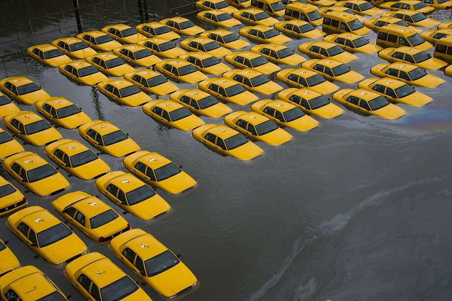 Good luck getting a cab in Hoboken, N.J. Sandy sidelined this fleet of cabs indefinitely. Photo: Charles Sykes, Associated Press