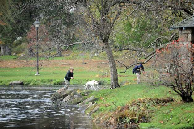 Two boys plays with their dog at Binney Park in Old Greenwich, Conn. Tuesday, Oct. 30, 2012, after the storm from Hurricane Sandy. Photo: Helen Neafsey / Old Greenwich