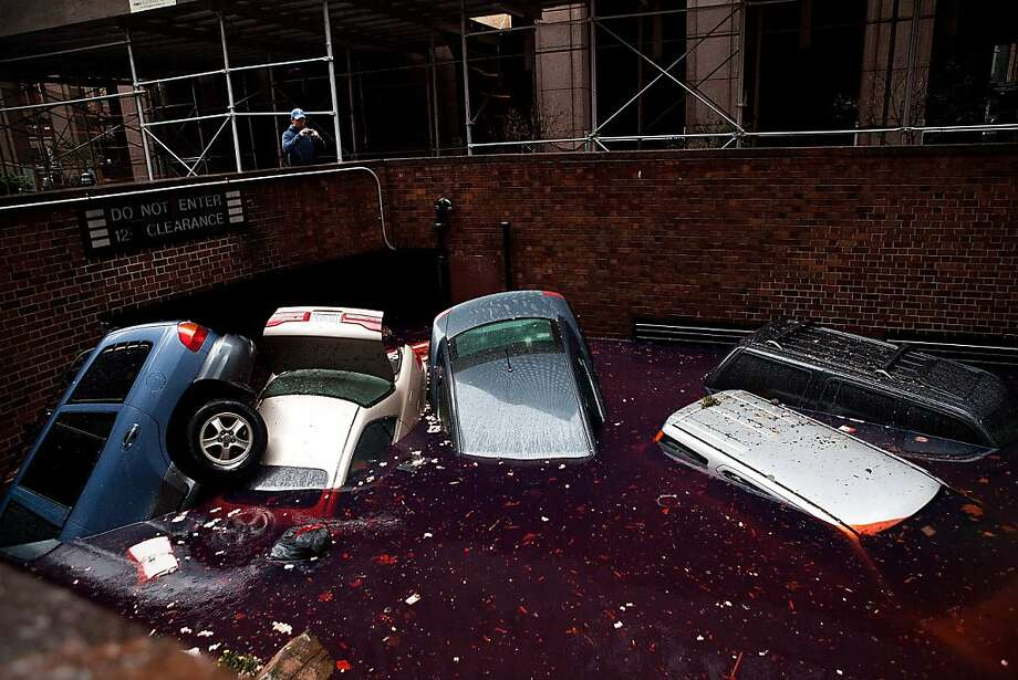 Cars floating in a flooded subterranian basement following Hurricaine Sandy on October 30, 2012 in the Financial District of New York, United States. The storm has claimed at least 33 lives in the United States, and has caused massive flooding across much of the Atlantic seaboard. US President Barack Obama has declared the situation a 'major disaster' for large areas of the US East Coast including New York City. Photo: Andrew Burton, Getty Images