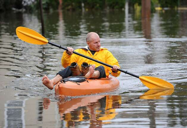 Boro Sangulin paddles a kayak through a flooded 16th Street from the effects of superstorm Sandy in on Tuesday, Oct. 30, 2012, in Bayville, N.Y. Sangulin was checking on the flood damage of his home at the end of the block. Photo: Kathy Kmonicek, Associated Press