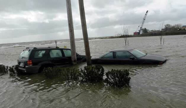 Parked cars on Candee Avenue in Sayville, New York are still swamped with water from Hurricane Sandy, Tuesday, October 30, 2012. (Thomas A. Ferrara/Newsday/MCT) Photo: Thomas A. Ferrara, McClatchy-Tribune News Service / ARCHIVE