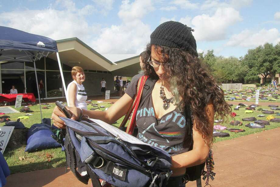 Jade Villarreal-Ross reads the contents of some of the 1,100 backpacks on display at Alvin Community College. The college hosted a traveling exhibit Oct. 22 called Send Silence Packing. Jade Villarreal-Ross reads the contents of some of the 1,100 backpacks on display at Alvin Community College. The college hosted a traveling exhibit Oct. 22 called Send Silence Packing. Photo: Pin Lim, Freelance / Copyright Pin Lim.