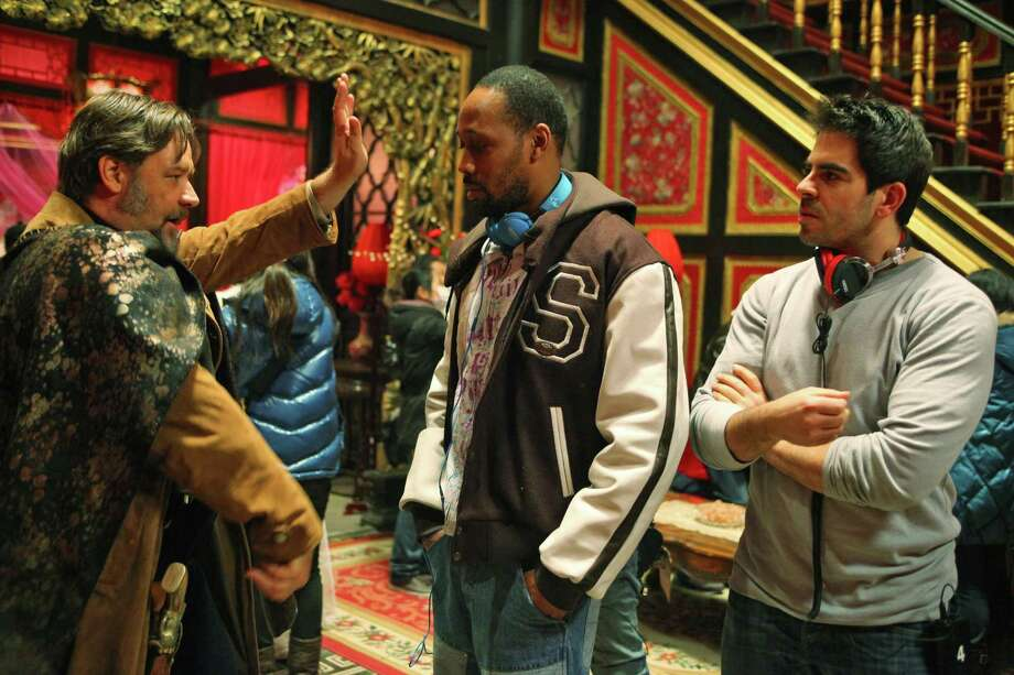 "Actor Russell Crowe (from left), rapper-turned-director RZA and screenwriter Eli Roth work on the set of ""The Man With the Iron Fists."" Photo: Universal Pictures / Universal Pictures"