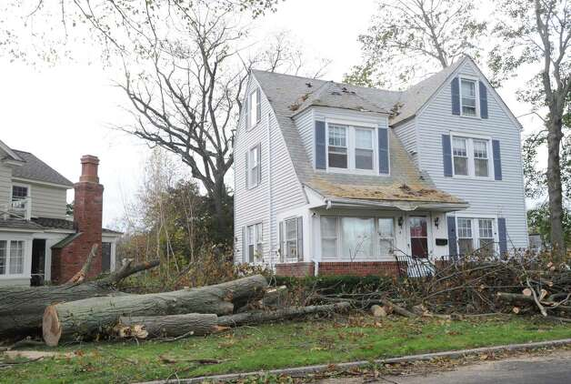 A storm-damaged home on East Elm Street in Greenwich, Tuesday, Oct. 30, 2012, during the aftermath of Hurricane Sandy. Photo: Bob Luckey / Greenwich Time