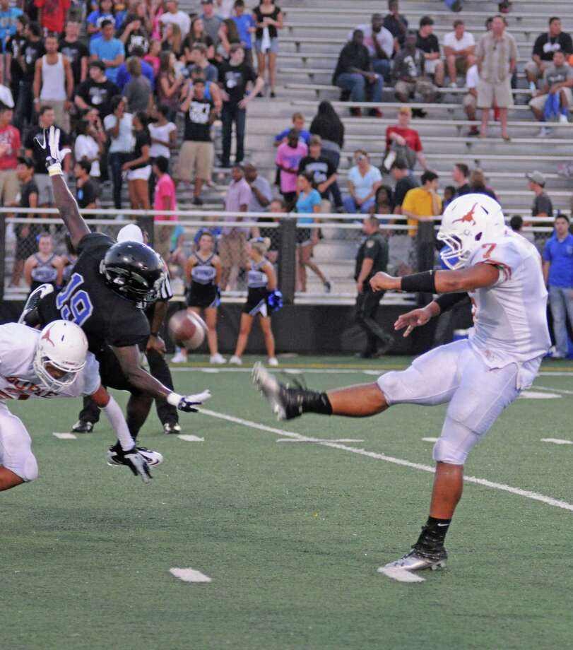 Clear Springs' LaDamian Coney (19) comes close to blocking a punt during a 26-14 loss to Dobie on Sept. 6, 2012 in League City. Since then, the Chargers have won six in a row, including a 5-0 start in District 24-5A, and that puts them a first-place deadlock with Clear Creek. Photo: L. Scott Hainline / The Chronicle
