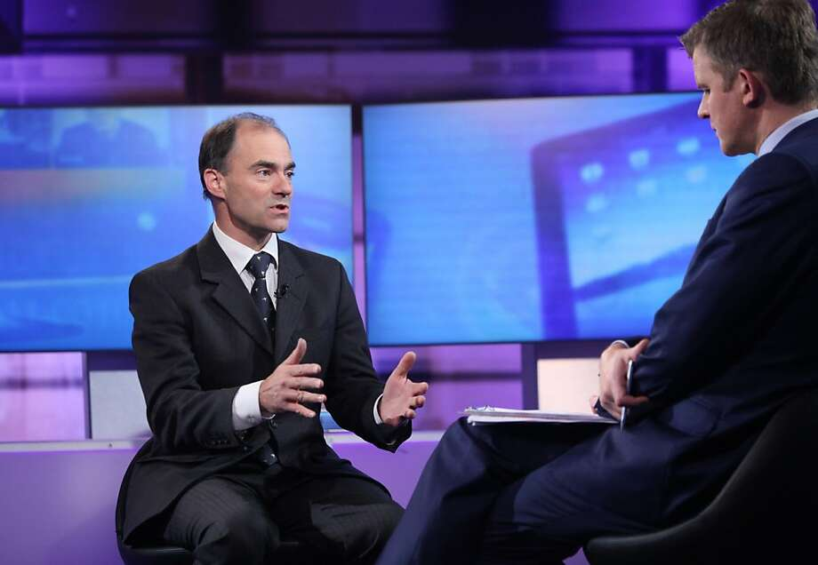 Warren East, CEO of ARM Holdings (left), seen during a London television interview in January, says the company wants to challenge Intel in the server market. Photo: Viber Media, Inc., Bloomberg