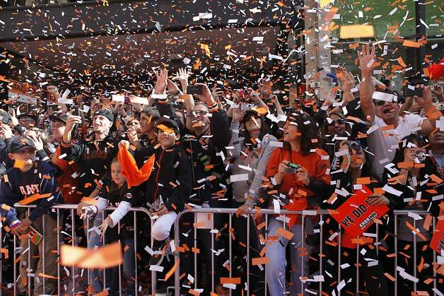 After the San Francisco Giants won the World Series, confetti falls fall an fans as the Giants make their way in the victory parade on Wednesday Nov. 03, 2010 in San Francisco, Calif. Photo: Mike Kepka, The Chronicle