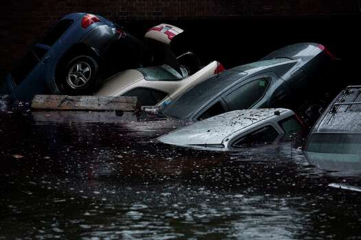 A parking garage in the Wall Street area under floodwaters in the Manhattan borough of New York, Oct. 30, 2012. Hurricane Sandy moved inland Tuesday after grinding life to a halt for millions of people in more than a half-dozen states, leaving behind the daunting task of cleaning up. Photo: DAMON WINTER, New York Times / NYTNS