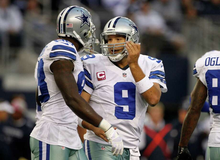 Dallas Cowboys wide receiver Dez Bryant and quarterback Tony Romo talk at the line of scrimmage during a NFL football game against the New York Giants Sunday, Oct. 28, 2012, in Arlington, Texas. The Giants defeated the Cowboys 29-24. (AP Photo/Tony Gutierrez) Photo: Tony Gutierrez, Associated Press / AP