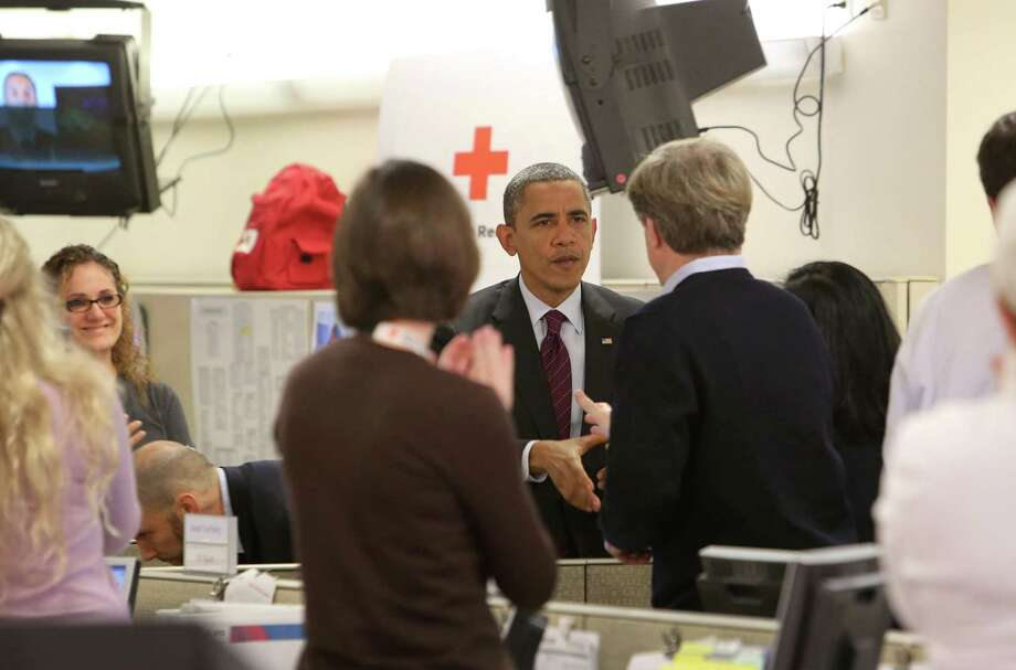 "President Barack Obama visits Red Cross headquarters Tuesday in Washington, D.C. He has declared a ""major disaster"" for large areas of the U.S. East Coast. Photo: Pool / Getty Images North America"