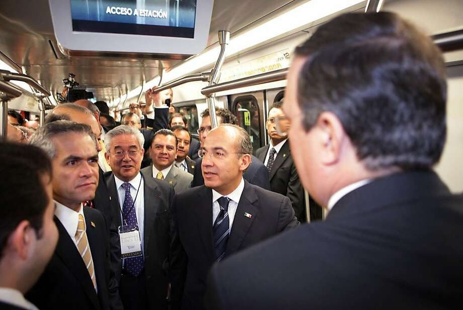 Mexico's President Felipe Calderon (wearing glasses) rides the new subway on its inaugural run in Mexico City. The line reaches deep into poor districts, which have relied mainly on buses. Photo: Handout, McClatchy-Tribune News Service