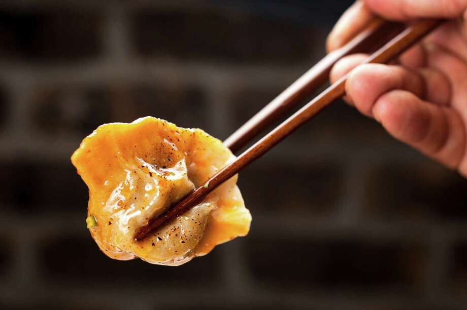 Dumplings are winning over new fans thanks to some creative interpretations, such as boiled dumplings stuffed with lamb, above, and a trendy  dish of dumplings floating in broth. Photo: KARSTEN MORAN, STR / NYTNS