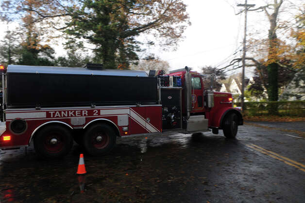A Greenwich Fire Department tanker truck leaves Binney Lane where a fire destroyed multiple homes during weather from Hurricane Sandy in Old Greenwich, Conn., Oct. 30, 2012. Photo: Keelin Daly