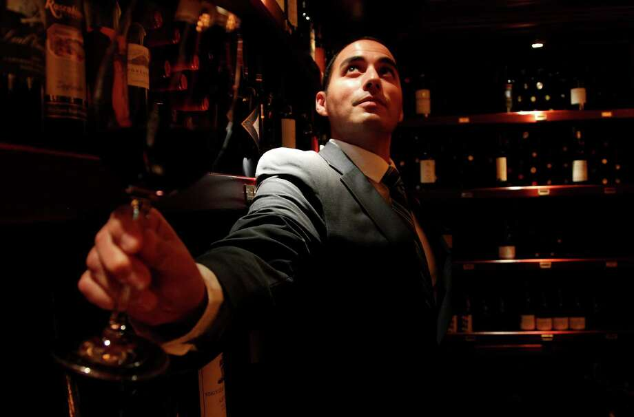 Pappas Bros. Steakhouse sommelier Steven McDonald suggests the 2007 Passopisciaro Sicilia Rouge with appetizers and entrees. Photo: Mayra Beltran, Staff / © 2012 Houston Chronicle