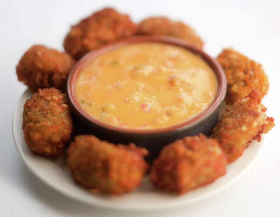Home-made tator-tots with dipping sauce. (Bill Hogan/Chicago Tribune/MCT) Photo: Bill Hogan, MBR / ARCHIVE