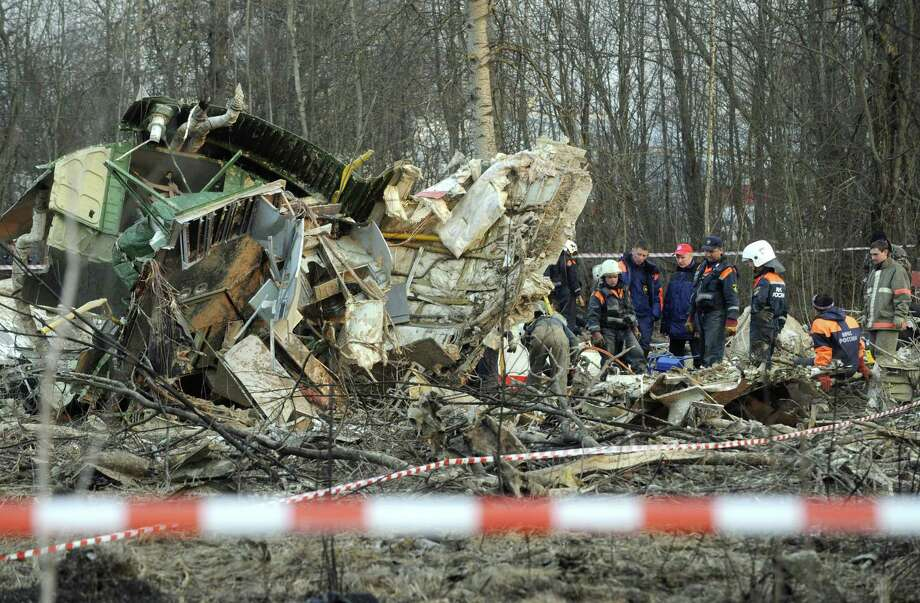 Russians inspect the wreckage of the Polish government plane crash that killed President Lech Kaczynski and other senior officials in 2010 in western Russia. Photo: NATALIA KOLESNIKOVA, AFP/Getty Images / AFP