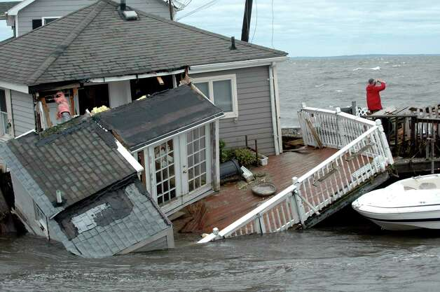 Tropical Storm Irene late last August heaved thishome on Fairfield Beach Road into Pine Creek. Photo: Cathy Zuraw