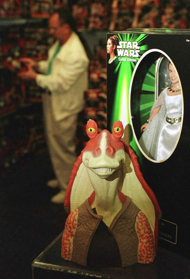 DO NOTbring back Jar Jar Binks or any other horribly annoying characters from the movies. I'm looking at you, Sy Snootles. Photo: MATT CAMPBELL, AFP/Getty Images / AFP