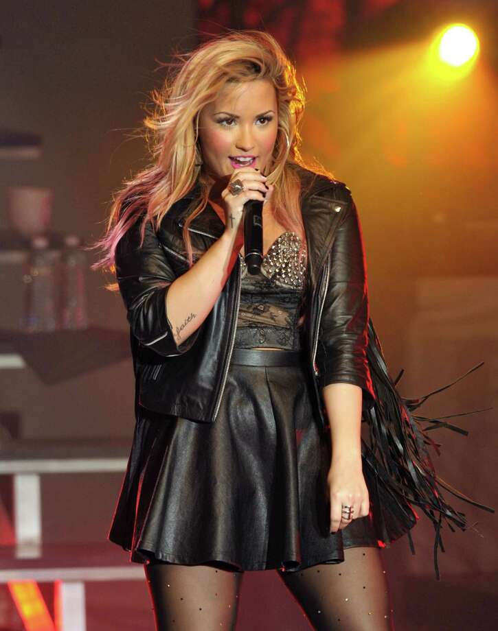 Demi Lovato performing during her summer concert tour at the Greek Theatre in Los Angeles in 2012.  (Photo by John Shearer/Invision/AP, file) Photo: John Shearer, INVL / Invision