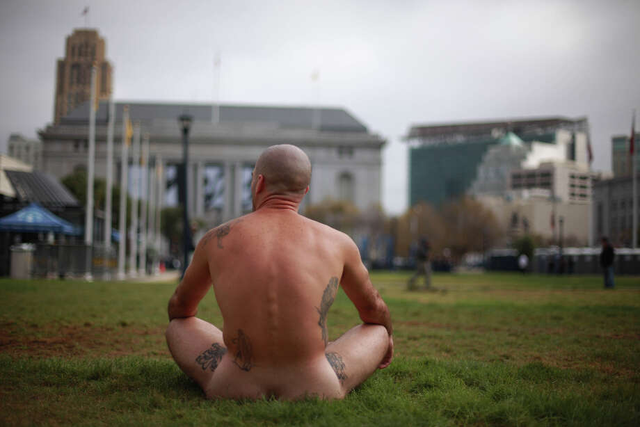 Ocean, from the East Bay, sits without clothes on across from City Hall as he and other demonstrators protest Supervisor Scott Weiner's proposal to restrict public  nudity in the city  on Tuesday, October 30, 2012 in San Francisco, Calif. Photo: Lea Suzuki, The Chronicle / ONLINE_YES
