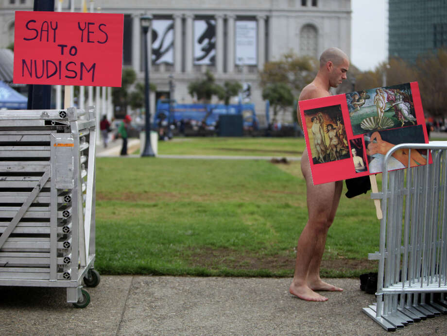 Ocean, from the East Bay, removes his clothes across from City Hall as he and other demonstrators gather to  protest Supervisor Scott Weiner's proposal to restrict public  nudity in the city  on Tuesday, October 30, 2012 in San Francisco, Calif. Photo: Lea Suzuki, The Chronicle / ONLINE_YES
