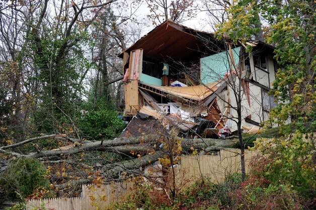This house overlooking Candlewood Lake near the Pleasant Acres Beach in Danbury was heavily damaged reportedly by falling trees from the high winds of Hurricane Sandy, Tuesday, Oct. 30, 2012. Photo: Carol Kaliff