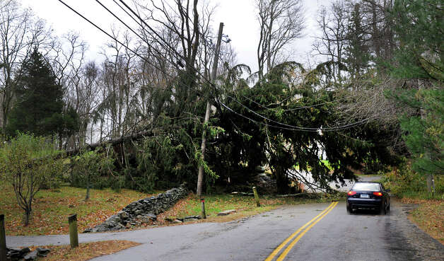 A huge tree, felled by the high winds of Hurricane Sandy ,lies across the a road on the Ridgefield/ Wilton border, Tuesday, Oct. 30, 2012. Photo: Carol Kaliff
