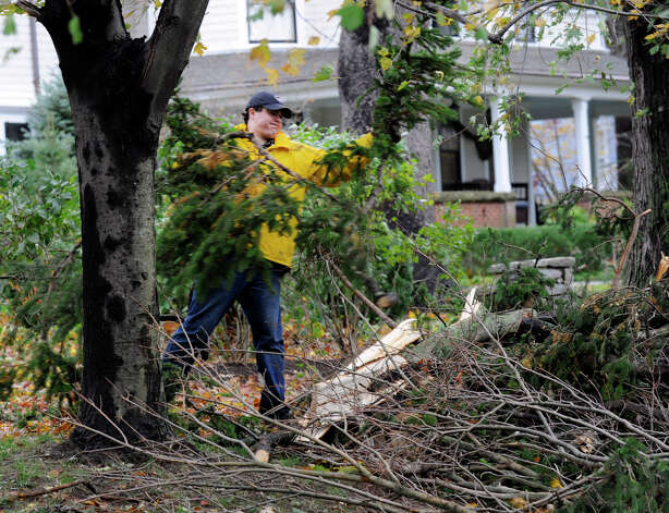 David Loehr, 24, clears wood from a tree that fell on his family's home on Main Street in Ridgefield, Conn., Tuesday, Oct. 30, 2012, during Hurricane Sandy. Photo: Carol Kaliff