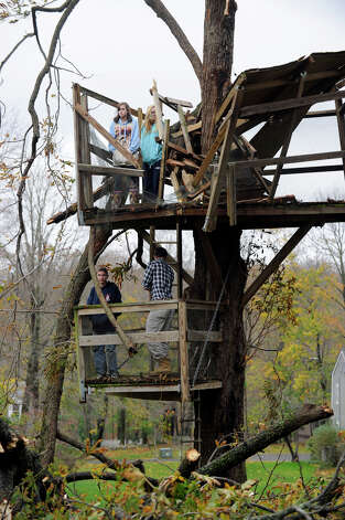 The Haynes children, Walker, 18, Haden, 14, Amelia, 15, and Lydia, 16, stand in what was a three-story tree house that Walker and his father, Doug, built in 2006 at their Ridgefield, Conn. home. The tree house was destroyed during the high winds of Hurricane Sandy. Photo: Carol Kaliff
