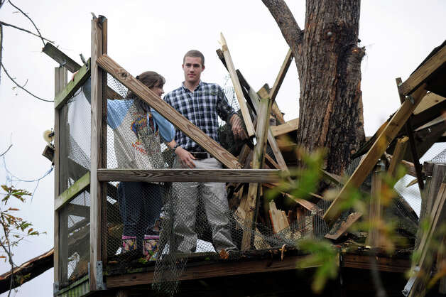 Lydia Haynes, 16, left and her brother, Walker, 18, stand in what's left of the family's three-story tree house that was heavily damaged during Hurricane Sandy, Tuesday, Oct. 30, 2012. Photo: Carol Kaliff