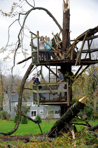 The Haynes children, Walker, 18, Haden, 14, Amelia, 15, and Lydia, 16, stand in what was a three-story tree house that Walker and his father, Doug, built in 2006 at their Ridgefield, Conn. home, Tuesday, Oct. 30, 2012. The tree house was destroyed during the high winds of Hurricane Sandy. Photo: Carol Kaliff