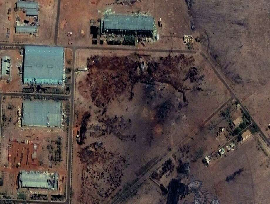 Part of the Yarmouk military complex in Khartoum, Sudan, seen in a satellite image made last week following an alleged attack. A U.S. monitoring group says satellite images suggest the site was hit by an airstrike. Photo: Uncredited, HOPD / DigitalGlobe