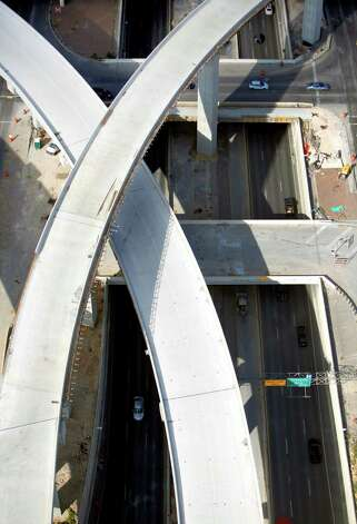 The still-under-construction ramps on the south side of U.S. 281 that connect to Loop 1604 are seen in this Oct. 25, 2012 aerial photo as U.S. 281 runs from the top to the bottom of the image. Photo: William Luther, San Antonio Express-News / © 2012 San Antonio Express-News
