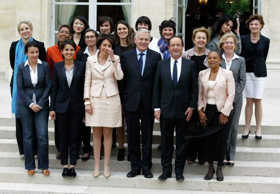 French President Francois Hollande, second from right, and Prime Minister Jean-Luc Ayrault, center, shown with the women of the Cabinet, have been forced to deal with claims that France lags in gender equality. Photo: Michel Euler, STF / AP